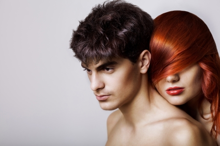 fashion couple with hairstyle, red head girl with hairs on the face, nude, studio shot