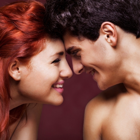 portrait of happy fashion couple laughing to each other Stock Photo