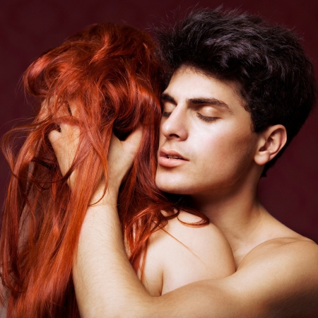 passion portrait of man hugging redhead woman