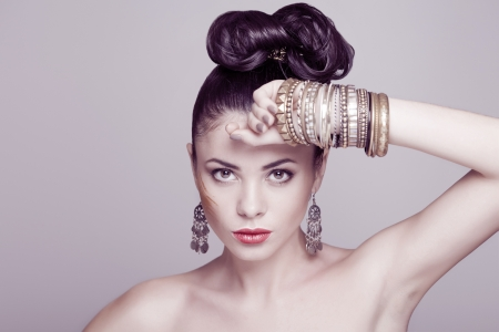 bangle: fashion model with hairstyle and jewelry, studio shot