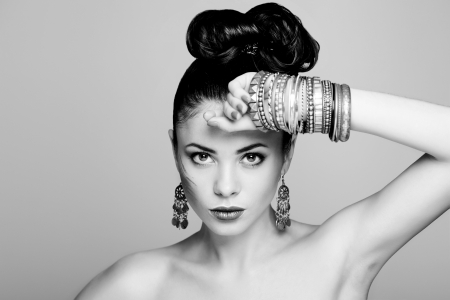 bangle: fashion model withhairstyle and jewelry, studio shot, black and white