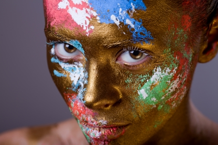 bodypainting: portrait of beautiful girl with face and body art, close up