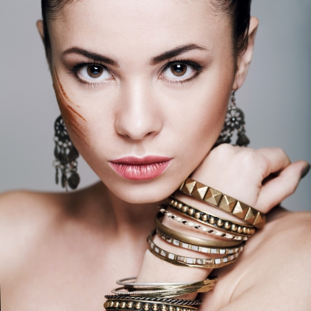 Beautiful woman with evening make-up. Jewelry and Beauty