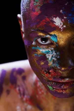Close-up portrait of an artistic woman painted Stock Photo