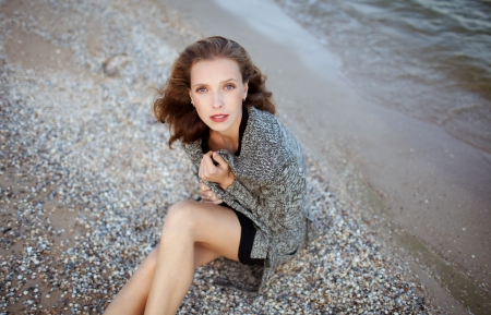 fashion model posing on the beach, emotional  portrait