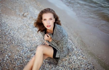 fashion model posing on the beach, emotional  portrait