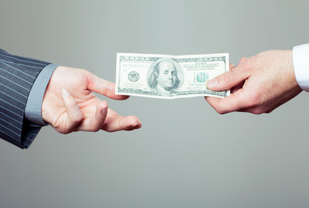 two dollar bill: Hand handing over money to another hand