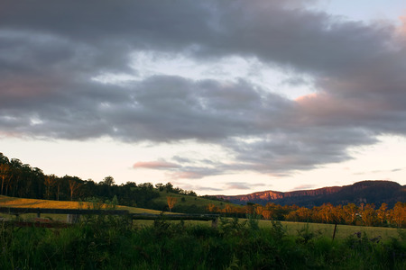 Australian landscape on the sunset, fields and mountains photo