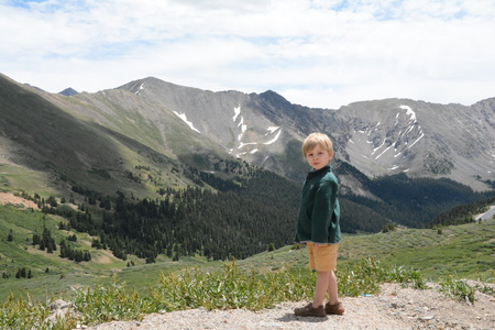 Boy in green mountains