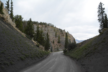 Winding scenic road through mountains.