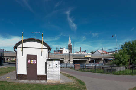 urbanistic: Photo from center of small european city Kralupy with utility building in foreground and railroad and church on background