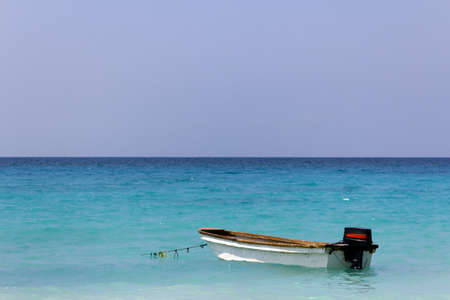 A small boat anchored in the caribbean sea near Cartagena de Indias, Colombia Stock Photo
