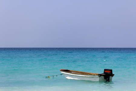 A small boat anchored in the caribbean sea near Cartagena de Indias, Colombia Stock Photo