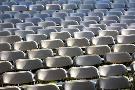 A sea of chairs - hundreds of chairbacks waiting outside for people ot sit in them at Harvard Commencement 2011 in Cambridge, MA