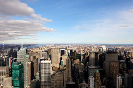 A view of the Manhattan cityscape, facing uptown, zfrom the Empire State Building in New York, NY.
