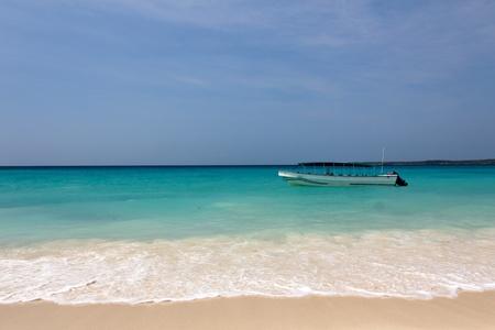 A small boat anchored at a caribbean beach near Cartagena de Indias, Colombia Stock Photo