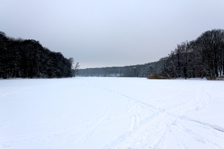 View over the frozen lake Schlachtensee in Berlin, Germany.