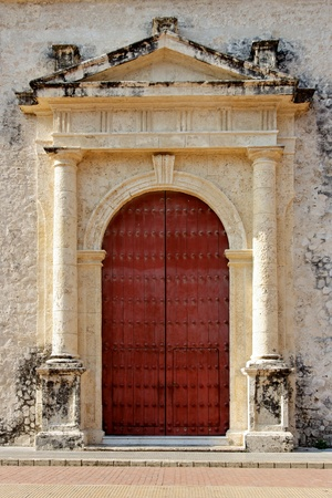 A traditional colonial era door in the streets of Cartagena de Indias, Colombia.