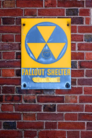 A weathered sign announcing a fallout shelter on an abandoned building on the Eastern seabord of the USA.