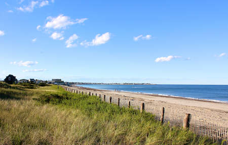 A Cape Cod, MA, New England beach lying in the afternoon sun