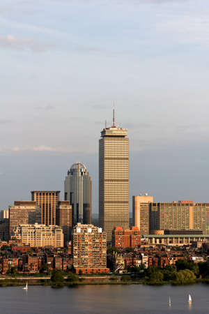 View of the Boston, MA Skyline of Back Bay, including the landmark Prudential Tower  Seen from near Kendall MIT across the Charles river in Cambridge, MA  photo