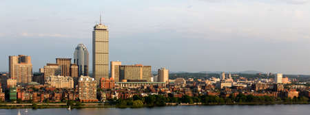 Panoramic view of the Boston, MA riverfront neigborhoods of Back Bay and Brookline, including the landmark Prudential Tower  Seen from near Kendall MIT across the Charles river in Cambridge, MA  photo