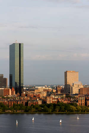 View of the Boston, MA riverbanks of Back Bay, including the landmark John Hancock Tower  Seen from near Kendall MIT across the Charles river in Cambridge, MA  photo