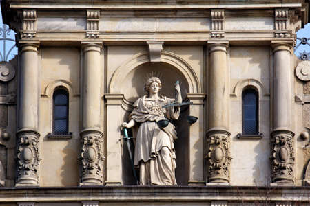 Justitia, Lady Justice, standing with scale and sword on the facade of the Strafjustiz Geba?ude  criminal justice building  in Hamburg, Germany