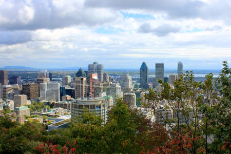 A view of Montreal, Quebec past the trees on the hill at Parc du Mont-Royal