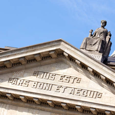 equitable: The facade of the Hanseatisches Oberlandesgericht court building in Hamburg, Germany shows the famous definition of law by Roman jurist Publius Iuventius Celsus: Law is the Art of the Good and the Equitable. Editorial