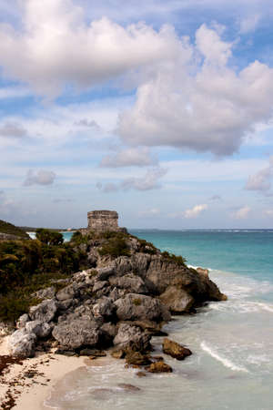 View of the Cliffs with Mayan ruins above the ocean at Tulum, Quintana Roo, Mexico.
