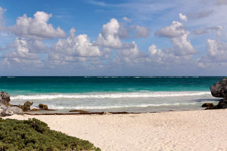 View from a Caribbean beach out over the turquoise ocean towards the horizon at Tulum, Quintana Roo, Mexico Stock Photo