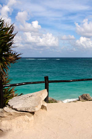 roo: View past a sandy plateau over the turquoise ocean towards the Caribbean horizon at Tulum, Quintana Roo, Mexico.