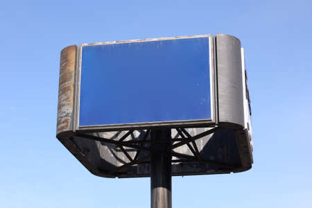An empty blue sign before a clear blue sky. Stock Photo
