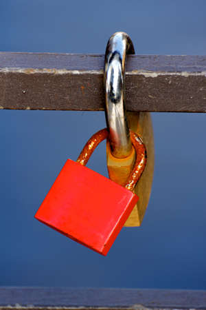 Love Padlocks or Love Locks, a modern symbol of lov and marriage, attached to a bridge.