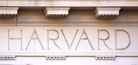 The Word 'Harvard' chiseled into the limestone of a university building in Cambridge, MA (taken on August 5, 2011)
