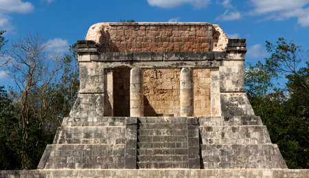 Building of Mayan origin, thought to be a ceremonial throne room, rises out of the jungle at Chichen  Stock Photo