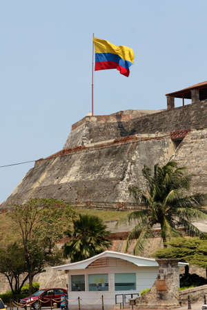 A Colombian flag is streaming in the wind over the fortress of Castillo San Felipe de Barajas in Cartagena de Indias, Colombia