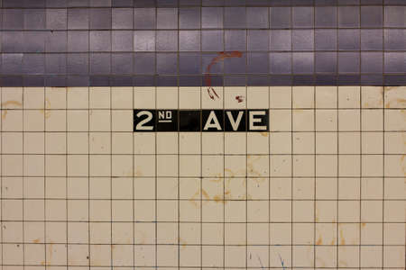 Sign on the tiled wall in Manhattan