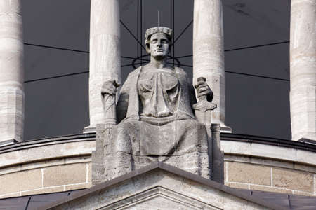 Justitia, Lady Justice, sitting on her throne above the portal of the Hanseatisches Oberlandesgericht (Supreme Hanseatic Court) of Hamburg, Germany.
