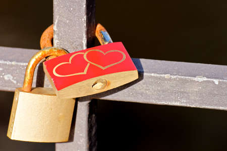 Love Padlocks or Love Locks, a modern symbol of lov and marriage, attached to a bridge. Stock Photo - 17245672