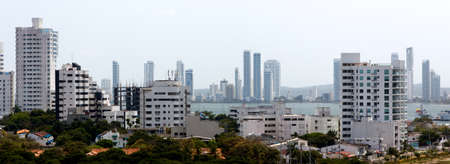 medellin: A panoramic view of apartment towers forming a white skyline in Cartagena de Indias, Colombia.