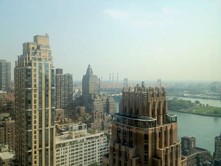 View towards the Queensboro Bridge from East Midtown Manhattan in New York, NY, USA.