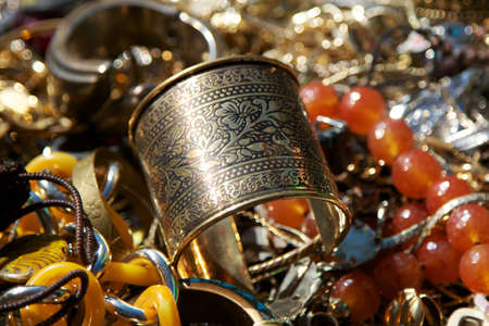 Detail of all sorts of glittering vintage jewelry heaped on top of one another. photo
