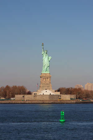 hudson river: The Statue of Liberty on Liberty Island, New York, NY, USA, in Fall.