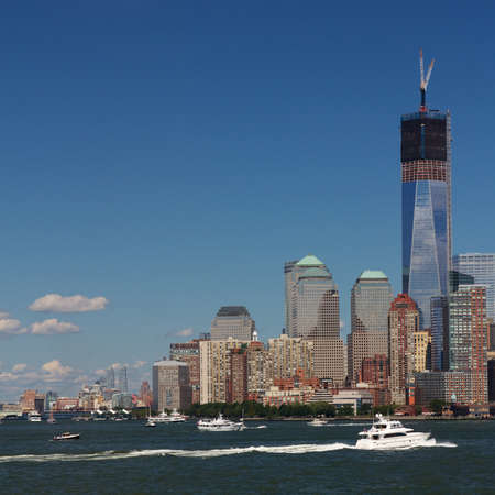 Section of the skyline of Manhattan, New York, NY, USA, at Battery Park with the Freedom Tower under construction.
