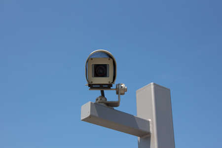 beholder: Modern outdoor surveillance camera aiming straight at the beholder  Stock Photo