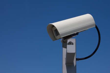 Modern outdoor surveillance camera facing left  photo