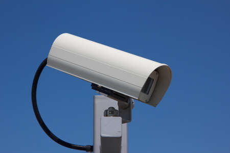 facing right: Close-up of modern outdoor surveillance camera facing right