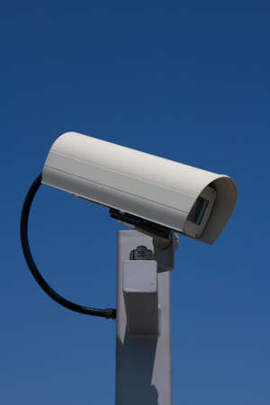 Close-up of modern outdoor surveillance camera facing right  photo